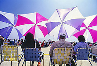 Colorful umbrellas and chairs at Andrews Air Force base airshow in Maryland.
