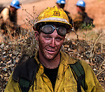 August 20, 1992 Angels Camp, California -- Old Gulch Fire—  Fulton Hotshot  firefighter on Sheep Ranch Road. The Old Gulch Fire raged over some 18,000 acres, destroying 42 homes while threatening the Mother Lode communities of Murphys, Sheep Ranch, Avery and Forest Meadows.