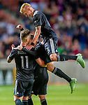 Real Salt Lake defender Justen Glad (15) leaps atop Real Salt Lake midfielder Albert Rusnak (11) after Rusnak scored in the second half Saturday, April 21, 2018, during the Major League Soccer game at Rio Tiinto Stadium in Sandy, Utah. RSL beat the Colorado Rapids 3-0. (© 2018 Douglas C. Pizac)