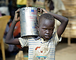 A displaced boy carries a can of cooking oil in Agok, a town in the contested Abyei region where tens of thousands of people fled in 2011 after an attack by soldiers and militias from the northern Republic of Sudan on most parts of Abyei. Although the 2005 Comprehensive Peace Agreement called for residents of Abyei--which sits on the border between Sudan and South Sudan--to hold a referendum on whether they wanted to align with the north or the newly independent South Sudan, the government in Khartoum and northern-backed Misseriya nomads, excluded from voting as they only live part of the year in Abyei, blocked the vote and attacked the majority Dinka Ngok population. The African Union has proposed a new peace plan, including a referendum to be held in October 2013, but it has been rejected by the Misseriya and Khartoum.