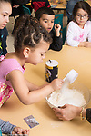 Education Preschool 4-5 year olds group of children making play dough, taking turns adding ingredients