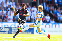 Alex Iwobi of Arsenal gets the ball away from Alex Pritchard of Huddersfield Town during the Premier League match between Huddersfield Town and Arsenal at the John Smith's Stadium, Huddersfield, England on 13 May 2018. Photo by Thomas Gadd / PRiME Media Images.