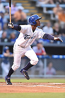 Asheville Tourists designated hitter Raimel Tapia #15 swings at a pitch during a game against the Hagerstown Suns at McCormick Field on September 9, 2014 in Asheville, North Carolina. The Suns defeated the Tourists 4-3. (Tony Farlow/Four Seam Images)