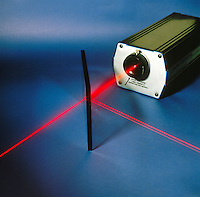 TRANSMISSION & REFLECTION of GAS LASER BEAM (2 of 2)<br /> By Glass Plate At Angle Other Than 90'<br /> Beam of Helium neon laser passing through glass at angle other than 90'is reflected. The presence of two reflected beams is due to reflection off the front and back surfaces of the glass plate.