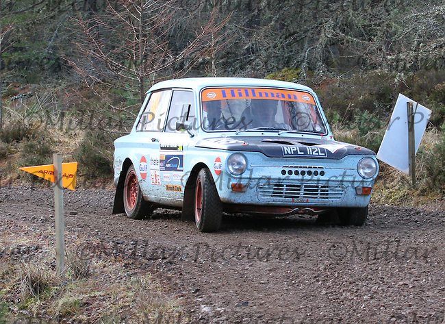 Rod Manson - Ewan Manson in a Hillman Imp competing at Junction 6 on the Munro Scotch Beef Millbuie Special Stage 1 on the 2014 Arnold Clark/Thistle Hotel Snowman Rally, supported by Highland Office Equipment, part of Capital Document Solutions which was organised by Highland Car Club and based in Inverness on 22.2.14; Round 1 of the 2014 RAC MSA Scottish Rally Championship sponsored by ARR Craib Transport Limited.