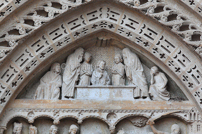 The entombment of St John the Evangelist, 13th century, from the tympanum of the Portail Saint Jean or St John Portal, on the Western facade of Rouen Cathedral or the Cathedrale de Notre Dame de Rouen, built 12th century in Gothic style, with work continuing through the 13th and 14th centuries, Rouen, Normandy, France. The St John Portal depicts scenes from the lives of the 2 St Johns. Picture by Manuel Cohen