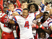 Manatee Hurricanes running back Purvis Goff #4 celebrates with teammates after the Florida High School Athletic Association 7A Championship Game at Florida's Citrus Bowl on December 16, 2011 in Orlando, Florida.  Manatee defeated First Coast 40-0.  (Photo By Mike Janes Photography)