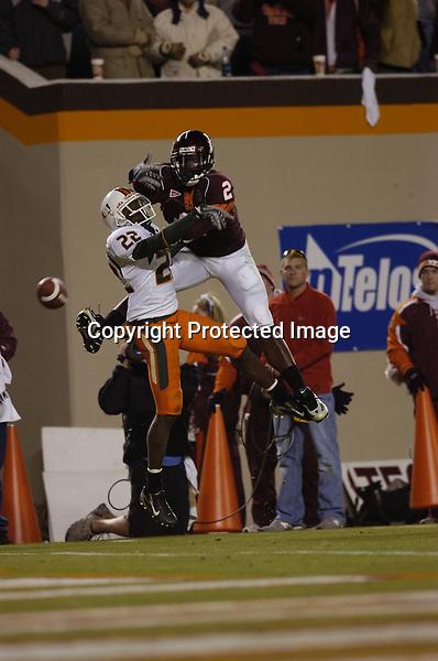 17 November 2007:  Miami CB Bruce Johnson (22) tips a ball away from Virginia Tech WR Josh Morgan (2).  The Virginia Tech Hokies defeated the Miami Hurricanes 44-14 November 17, 2007 at Lane Stadium in Blacksburg, VA..