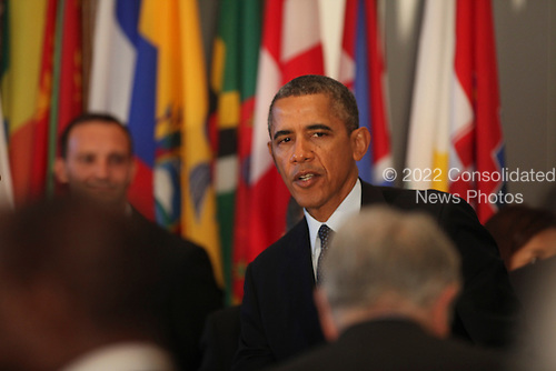 United States President Barack Obama attends the Delegates Luncheon at the 68th United Nations General Assembly in New York, New York on Tuesday, September 24, 2013.<br /> Credit: Allan Tannenbaum / Pool via CNP