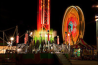 Fairground, big ferris wheel illuminated at night in Austin, Texas