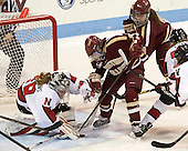 Chloe Desjardins (NU - 29), Melissa Bizzari (BC - 4), Taylor Wasylk (BC - 9), Kendall Coyne (NU - 77) - The Northeastern University Huskies defeated Boston College Eagles 4-3 to repeat as Beanpot champions on Tuesday, February 12, 2013, at Matthews Arena in Boston, Massachusetts.