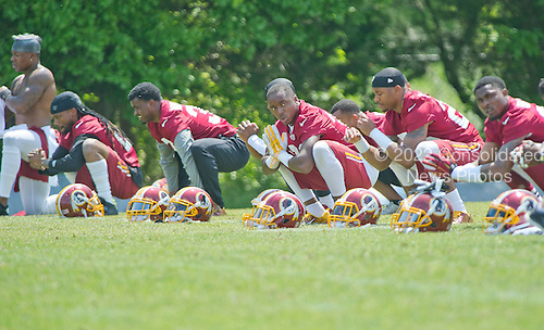 Washington Redskins players participate in warm-up drills during an organized team activity (OTA) at Redskins Park in Ashburn, Virginia on Wednesday, May 25, 2015.<br /> Credit: Ron Sachs / CNP