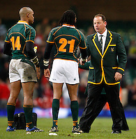 Photo: Richard Lane/Richard Lane Photography..Wales v South Africa. Prince William Cup. 24/11/2007. .South Africa coach, Jake White (rt) shakes hands with Akona Ndungane.