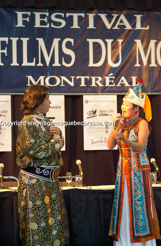 Aug 27,  2002, Montreal, Quebec, Canada<br /> <br /> Performance by Mongolia  singer  Er DMutu (L) and his musicians at <br />  the 26th Montreal World Film Festival, Aug 27 2002<br /> <br /> <br /> Mandatory Credit: Photo by Pierre Roussel- Images Distribution. (&copy;) Copyright 2002 by Pierre Roussel <br /> AP OUT<br /> <br /> NOTE : <br />  Nikon D-1 jpeg opened with Qimage icc profile, saved in Adobe 1998 RGB<br /> .Uncompressed  Uncropped  Original  size  file availble on request.