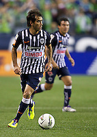 César Delgado CF Monterrey looks to pass the ball during a CONCACAF Champions League match against the Seattle Sounders FC at CenturyLink Field in Seattle Tuesday Oct. 18, 2011. CF Monterrey won the game 2-1.