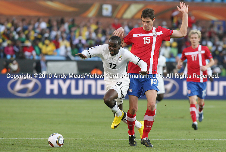 13 JUN 2010: Prince Tagoe (GHA) (12) is fouled by Nikola Zigic (SRB) (15). The Serbia National Team lost 0-1 to the Ghana National Team at Loftus Versfeld Stadium in Tshwane/Pretoria, South Africa in a 2010 FIFA World Cup Group D match.
