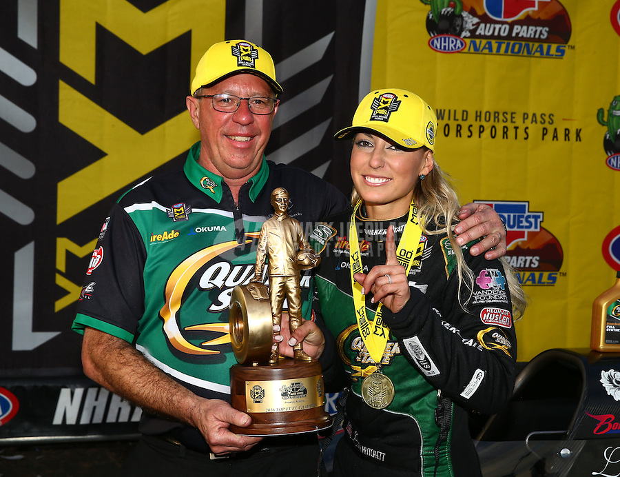 Feb 28, 2016; Chandler, AZ, USA; NHRA top fuel driver Leah Pritchett celebrates with crew chief Mike Guger after winning the Carquest Nationals at Wild Horse Pass Motorsports Park. Mandatory Credit: Mark J. Rebilas-
