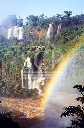 Iguassu Falls, Parana, State, Brazil; view of the waterfalls with a rainbow over them.