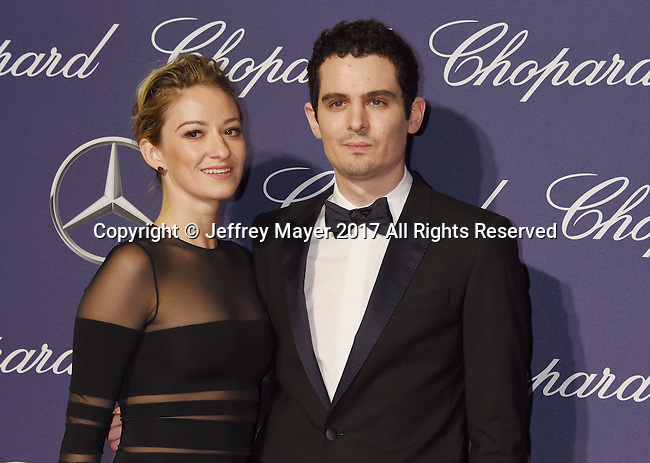 PALM SPRINGS, CA - JANUARY 02: Director Damien Chazelle (R) and actress Olivia Hamilton attend the 28th Annual Palm Springs International Film Festival Film Awards Gala at the Palm Springs Convention Center on January 2, 2017 in Palm Springs, California.