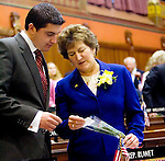 HARTFORD, CT- 03 JANUARY 07- 010307JT10-<br /> Anne Ruwet, R-Torrington, and her son, Torrington Mayor Ryan Bingham, read a note attached to a rose on Ruwet's desk on the opening day of the General Assembly's 2007 session on Wednesday at the Capitol in Hartford.<br /> Josalee Thrift Republican-American