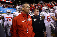 Ohio State Buckeyes head coach Urban Meyer enters the field field for warm-ups prior to the Big Ten championship football game between the Buckeyes and the Michigan State Spartans at Lucas Oil Stadium in Indianapolis on Dec. 7, 2013. (Adam Cairns / The Columbus Dispatch)