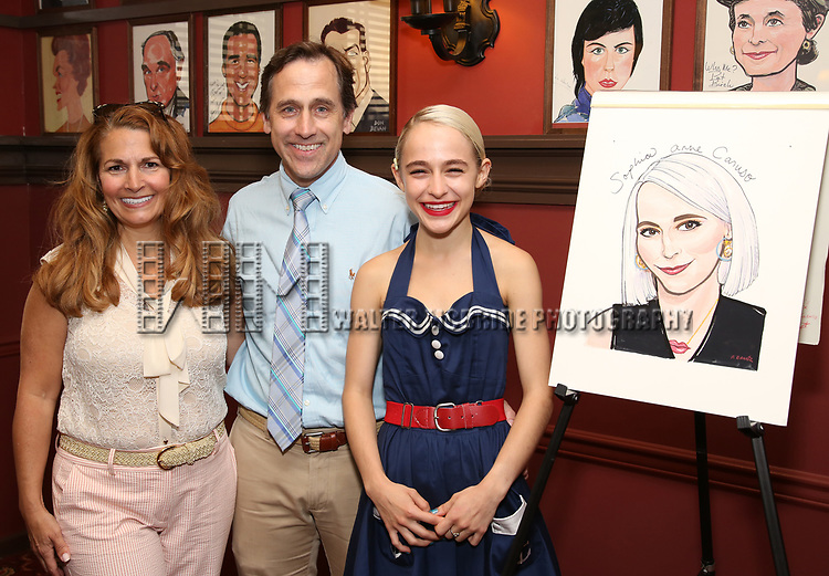 Sophia Anne Caruso with her mother, Deena Moe Caruso and Steve Caruso during the Sophia Anne Caruso Sardi's Portrait Unveiling at Sardi's on July 10, 2019 in New York City.