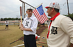 """Matt """"Scoops"""" Lurk, who is captain of the St. Louis Unions team, and Todd """"Dutch"""" Eschman talk during a game on August 4, 2012 at the Swansea Moose Lodge fields between the their two teams."""