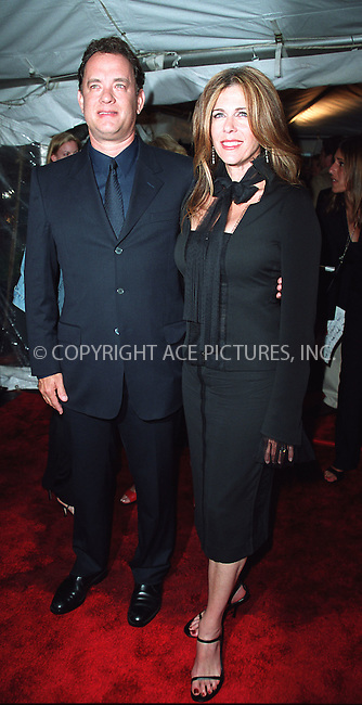 """Tom Hanks and wife Rita Wilson attending a special screening of """"Road to Perditon"""" to benefit the Association of the HITWG Camps and the International Rescue Committee. New York, July 9, 2002.  Please byline: Alecsey Boldeskul/NY Photo Press.   ..*PAY-PER-USE*      ....NY Photo Press:  ..phone (646) 267-6913;   ..e-mail: info@nyphotopress.com"""