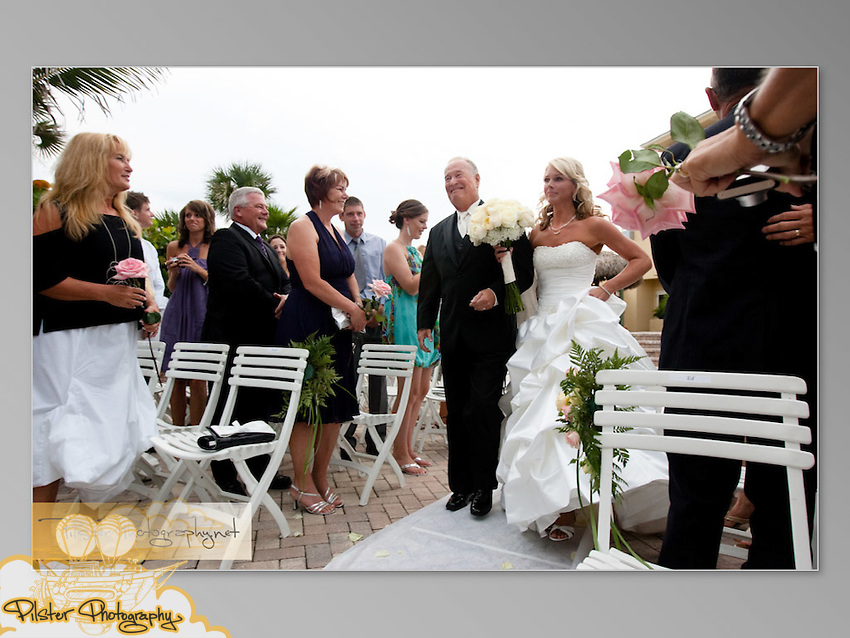 The wedding of Beth McDowell to Kyle Sherrit on Friday, August 21, 2009, at The Shores Resort and Spa in Daytona Beach Shores. Flowers were by Beach Street Blooms, DJ and lighting was Vern with Pyramid Disc Jockeys, dress by Maggie Sottero, hair and makeup was Kara Sánchez with Bobby Pins & Blush, and Beth designed the table numbers and menus. (Chad Pilster, http://www.PilsterPhotography.net)
