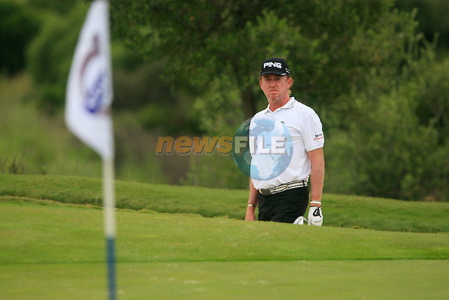 Miguel Angel Jimenez (ESP) chips out of a bunker at the 7th green during Day 2 of the Volvo World Match Play Championship in Finca Cortesin, Casares, Spain, 20th May 2011. (Photo Eoin Clarke/Golffile 2011)