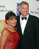 United States Secretary of Commerce Penny Pritzker and Bryan Traubert arrive for the formal Artist's Dinner honoring the recipients of the 2014 Kennedy Center Honors hosted by United States Secretary of State John F. Kerry at the U.S. Department of State in Washington, D.C. on Saturday, December 6, 2014. The 2014 honorees are: singer Al Green, actor and filmmaker Tom Hanks, ballerina Patricia McBride, singer-songwriter Sting, and comedienne Lily Tomlin.<br /> Credit: Ron Sachs / Pool via CNP