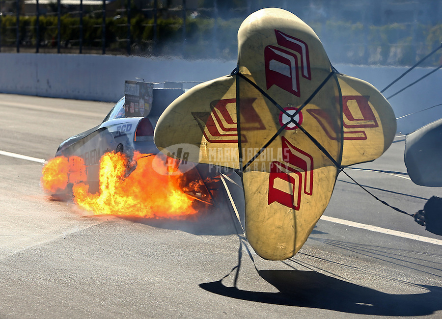 Nov 14, 2015; Pomona, CA, USA; NHRA funny car driver Tim Gibbons has a fire after blowing an engine during qualifying for the Auto Club Finals at Auto Club Raceway at Pomona. Gibbons was uninjured. Mandatory Credit: Mark J. Rebilas-USA TODAY Sports