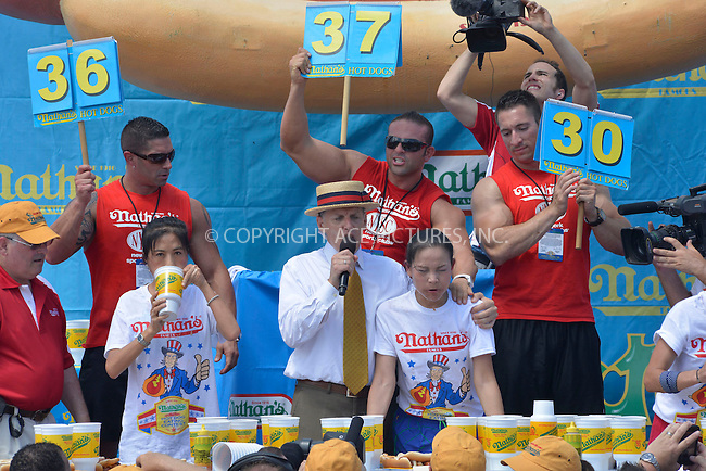 WWW.ACEPIXS.COM . . . . . <br /> July 4, 2013...New York City....Sonya &quot;The Black Widow&quot; Thomas at Nathan's Hotdog Eating Contest in Coney Island on  July 4, 2013 in New York City. ....Please byline: CURTIS MEANS - WWW.ACEPIXS.COM.. . . . . . ..Ace Pictures, Inc: ..tel: (212) 243 8787 or (646) 769 0430..e-mail: info@acepixs.com..web: http://www.acepixs.com