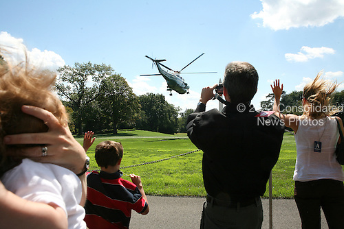 Marine One, with United States President Barack Obama aboard, takes off from the South Lawn of the White House as the President travels to Milwaukee, Wisconsin to deliver remarks on jobs and the economy on Monday, September 6, 2010.  .Credit: Gary Fabiano / Pool via CNP