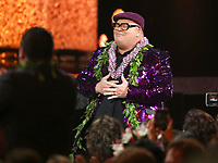 "Kalani Pe'a walks on stage to accept the award for best regional roots music album for ""No 'Ane'i"" at the 61st annual Grammy Awards on Sunday, Feb. 10, 2019, in Los Angeles. (Photo by Matt Sayles/Invision/AP)"