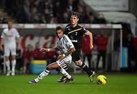 Pictured: Scott Sinclair of Swansea (L) is closely watched by Scott Parker (R) of Tottenham Hotspur. Saturday 31 December 2011<br />