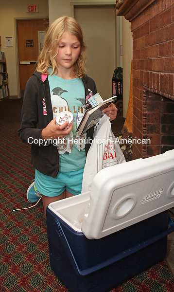 Winsted, CT-071815MK11 Sara Timmeney picks out a frozen treat after checking out some books  at the Beardsley and Memorial Library in Winsted Saturday afternoon.  Linda Gordon, program coordinator, said there was a selection of 100 items of ice cream, popsicles or frozen ices for children as well as adults to choose from.  The activity was held to celebrate national ice cream day, which is today, with those patrons who borrowed books or participated in the library's presentations.   Michael Kabelka / Republican-American