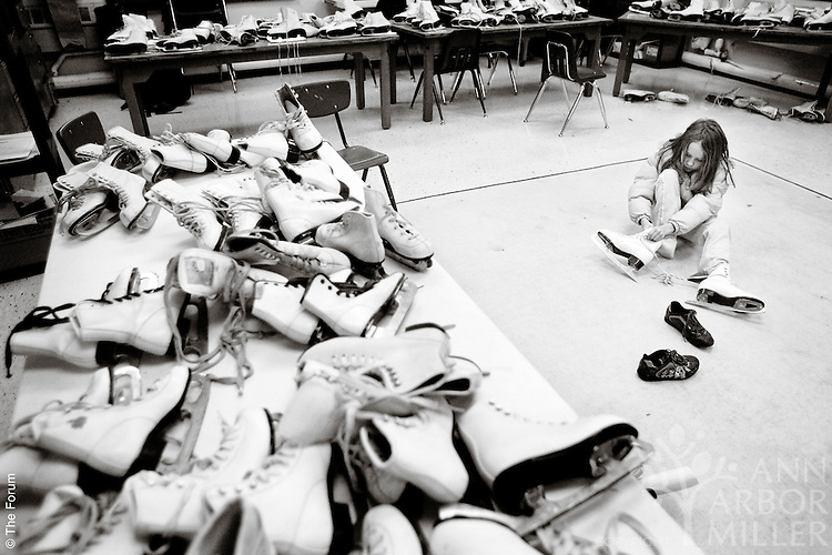 It's beautiful in its simplicity. Create a collection of used ice skates. Distribute the skates to interested school children at winter's start and collect them at winter's end. That's exactly what Fargo teacher Jane Norby has been doing for more than a decade. On a recent Tuesday, the art room in the basement of the Horace Mann building was temporarily converted into a fitting room for young skaters, including 7-year-old Paige Roquet (pictured).