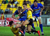 Ricky Riccitelli (left) and Matt Proctor tackle Pieter-Steph du Toit during the Super Rugby match between the Hurricanes and Stormers at Westpac Stadium in Wellington, New Zealand on Saturday, 23 March 2019. Photo: Dave Lintott / lintottphoto.co.nz