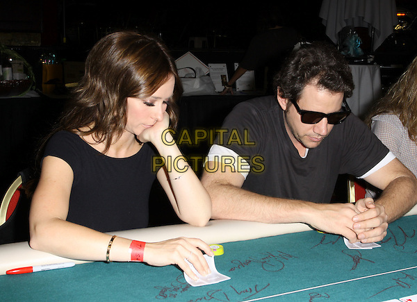 "JENNIFER LOVE HEWITT & JAMIE KENNEDY.Children's Institute Hosts ""Poker For A Cause"" Celebrity Poker Tournament held At Commerce Casino Hotel, City Of Commerce, California, USA..October 17th, 2009.half length black sunglasses shades couple playing cards looking down profile .CAP/ADM/KB.©Kevan Brooks/AdMedia/Capital Pictures."