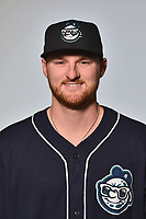 Asheville Tourists pitcher Bryan Baker (33) poses for a photo at Story Point Media on April 4, 2017 in Asheville, North Carolina. (Tony Farlow/Four Seam Images)