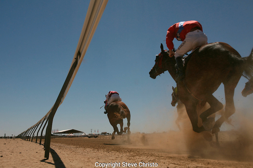 The Birdsville Races are horse races held each year in September in the Queensland, Australia, town of Birdsville. The races were first held in the small town in 1882 and in 2006 the meeting marked it's 125th anniversary. The population of Birdsville swells from about 100 to around 6,000 people for the two-day event. Queensland, Australia. 1st September 2006. (Photos Steve Christo).