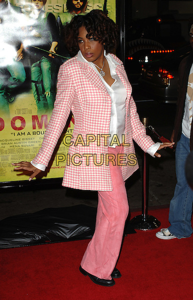 "MACY GREY.""Domino"" film premiere. .Grauman's Chinese Theartre, Hollywood, CA..USA, United States.12th October 2005.Ref:MOO.full length pink gingham jacket coat trousers arms held out curls ringlets posed.www.capitalpictures.com.sales@capitalpictures.com.©Capital Pictures."