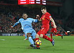 Liverpool's James Milner tussles with Stoke's Glen Johnson during the Premier League match at Anfield Stadium, Liverpool. Picture date December 27th, 2016 Pic David Klein/Sportimage