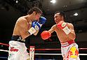 (L-R) Akira Yaegashi (JPN), Pornsawan Porpramook (THA), OCTOBER 24, 2011 - Boxing : Pornsawan Porpramook of Thailand in action against Akira Yaegashi of Japan during the fifth round of the WBA minimumweight title bout at Korakuen Hall in Tokyo, Japan. (Photo by Mikio Nakai/AFLO)