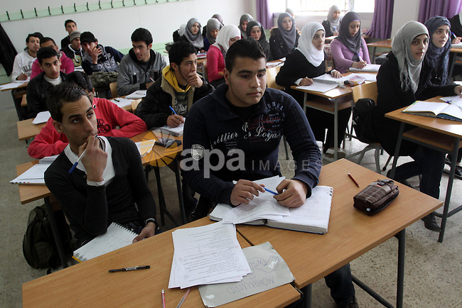 Palestinian students learn in the school Nahr al-Bared Palestinian refugee camp in Beirut, in Lebanon, March 6, 2012. About 25,000 person live in this poor refugee camp who face hard and difficult life.  Photo by Mohammed Asad