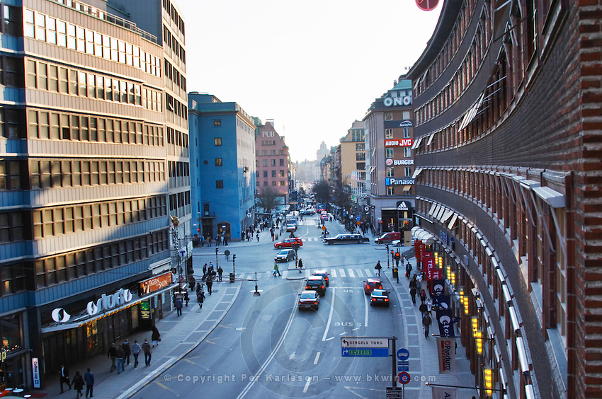 Sveavagen, The Svea Street, in the centre, one of the main streets, at sunset, with typical 1950s brick building. Norrmalm. Stockholm. Sweden, Europe.