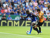 Leicester City's Ricardo Pereira shields the ball from Wolverhampton Wanderers' Joao Moutinho <br /> <br /> <br /> <br /> Photographer Stephen White/CameraSport<br /> <br /> The Premier League - Leicester City v Wolverhampton Wanderers - Sunday 11th August 2019 - King Power Stadium - Leicester<br /> <br /> World Copyright © 2019 CameraSport. All rights reserved. 43 Linden Ave. Countesthorpe. Leicester. England. LE8 5PG - Tel: +44 (0) 116 277 4147 - admin@camerasport.com - www.camerasport.com