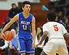 Cole Anthony #11 of Archbishop Molloy, left, surveys the court under pressure from Deven Williams #5 of Half Hollow Hills West during a varsity boys' basketball game at Long Island Lutheran High School on Sunday, Jan. 3, 2016. Archbishop Molloy defeated Hills West by a score of 70-56.