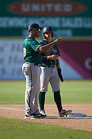 Greensboro Grasshoppers manager Miguel Perez (29) gives instructions to Brett Kinneman (27) during the game against the Hickory Crawdads at L.P. Frans Stadium on May 26, 2019 in Hickory, North Carolina. The Crawdads defeated the Grasshoppers 10-8. (Brian Westerholt/Four Seam Images)